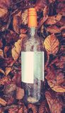 Discarded Wine Bottle. A Discarded `Morning After` Wine Bottle With A Blank Label For Your Text stock photo