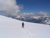 Discesa dell'alpinista Fotografie Stock Libere da Diritti