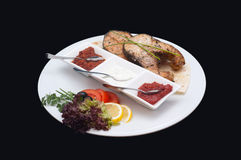 Disch of food. White plate with grilled fisch royalty free stock photography