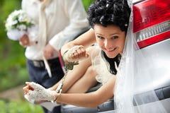 Discharge of captive bride. Groom discharging of captive bride from car trunk Stock Image