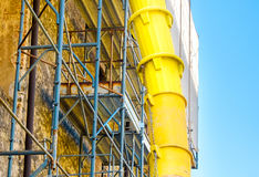 Discharge debris tube yard building.  Royalty Free Stock Photography