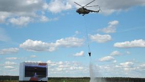 Discharge of water from a helicopter stock footage