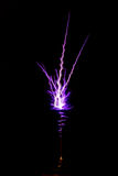 Discharges on a black background. Two big discharges from a Tesla coil instrument Stock Image
