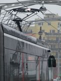The discharges at the pantograph the tram when contacting the trolley covered with ice Stock Photo