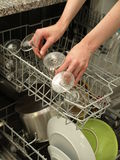 Discharging dishwasher Royalty Free Stock Photography