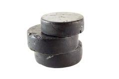 Dischi di gomma di hokey del ghiaccio Immagine Stock Libera da Diritti