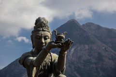 Disciple of Big Buddha. Bronze statue of disciple offering a gift to Big Buddha Royalty Free Stock Photos