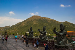 Disciple of Big Buddha. Disciple statues and mountain background Stock Photography