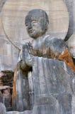 Disciple of Shakyamuni Buddha. Statue in Lingyun Mountain Grottoes, Nanchong, Sichuan, China Royalty Free Stock Photo