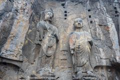 The disciples of Buddha carved stone in Longmen Grottoes Royalty Free Stock Photo
