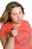 Discipline. A young preteen girl giving the viewer heck or discipline for something, isolated against a white background Stock Image