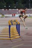 Discipline d'athlétisme - 100 obstacles de mètres Photographie stock libre de droits
