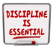 Discipline is Essential Words Dry Erase Board Commitment Control. Discipline is Essential words on a dry erase board to communicate the importance of being Royalty Free Stock Photos