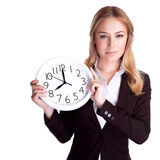 Discipline in office concept. Portrait of beautiful young business woman holding in hands clock, isolated on white background, discipline and punctual concept royalty free stock images