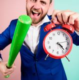 Discipline and sanctions. Boss aggressive face hold alarm clock and baseball bat. Man suit hold clock in hand and. Arguing for being late. Business discipline stock photography