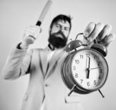 Discipline and sanctions. Boss aggressive face hold alarm clock. Destroy or turn off. Man suit hold clock and baseball. Bat in hands. Business discipline stock photos