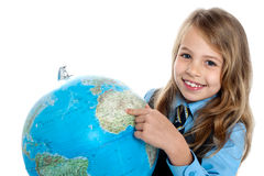 Disciplined child pointing at something on globe Stock Photography