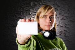 Discjockey with business card Royalty Free Stock Image