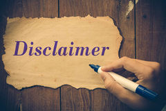 Disclaimer text write. By Businessman Royalty Free Stock Photos
