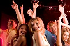 At disco. Image of happy young people having fun at disco royalty free stock images