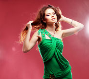 Disco. Fashion expressive girl dancing at disco light Royalty Free Stock Images