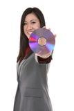 Disco asiatico della holding della donna Fotografia Stock