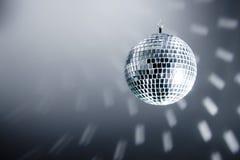 Disco Ball. Reflecting light to a grey wall Stock Photo