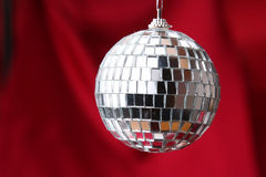 Disco ball. On red background Royalty Free Stock Photos