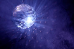 Disco Ball. And smoke on blue background with copyspace Royalty Free Stock Photo