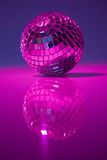 Disco ball. And blue purple light; party atmosphere Royalty Free Stock Images
