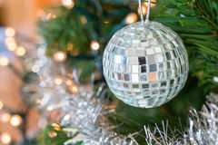 Disco ball as Christmas ball with mirrors in tree Royalty Free Stock Image