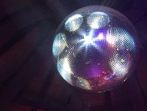 Disco ball on black background stock photography