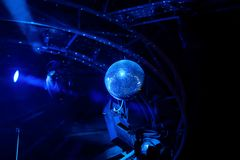 Disco ball with blue bright rays, night party background. Photo stock image