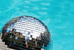Disco ball with blue water background Royalty Free Stock Image