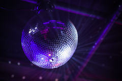 Disco ball with bright purple rays Royalty Free Stock Images