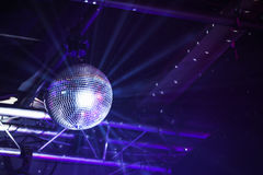 Disco ball with bright purple rays Stock Images