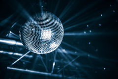 Disco ball with bright rays, blue toned Stock Image