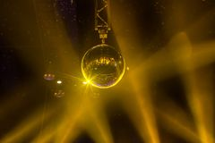 Disco ball with bright rays and night party background.  stock photo