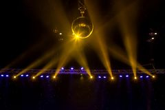 Disco ball with bright rays and night party background.  stock photography