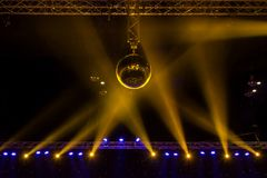 Disco ball with bright rays and night party background.  royalty free stock photo