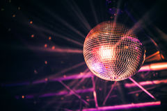 Disco ball with bright rays, night party Stock Images