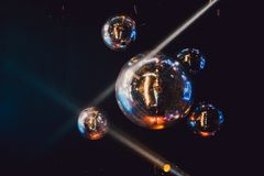Disco ball with bright rays, night party background photo. Disco ball with bright rays, night party background photo royalty free stock image