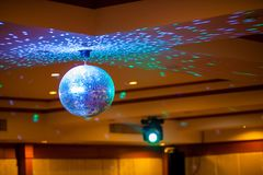 Disco ball with bright rays, night party background photo . party lights disco ball . stock photos