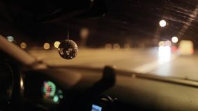 Disco ball in the car stock video footage