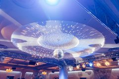 Disco ball in the concert hall. With a reflection on the ceiling royalty free stock image