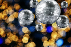 Disco ball and evening ornaments with lights Royalty Free Stock Photos