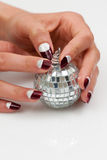Disco-ball in female hands Royalty Free Stock Photography