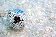 Disco ball on glitter. Disco ball decoration on white glitter great for backgrounds, tags or greeting card stock image