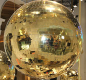 Disco ball. A gold colored disco ball Royalty Free Stock Photography