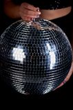 Disco ball in the hands of a woman. A symbol of music, clubs and nightlife.Holidays and fun parties. Disco ball in the hands of a woman. A symbol of music, clubs Royalty Free Stock Photos